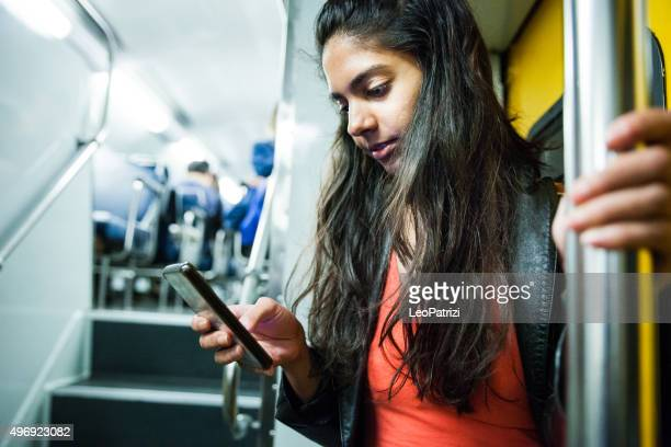 Woman commuting in a Sydney train and texting