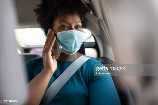 woman commuting in a taxi wearing face mask - plus size model stock pictures, royalty-free photos & images