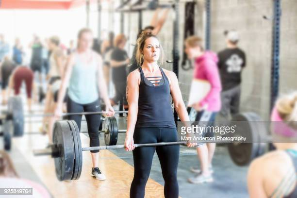 Woman competing in weightlifting competition