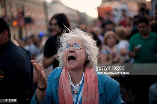 A woman complains about the noise of banging pots during a demonstration against labor reform and the bailout at Puerta del Sol Square on June 10...