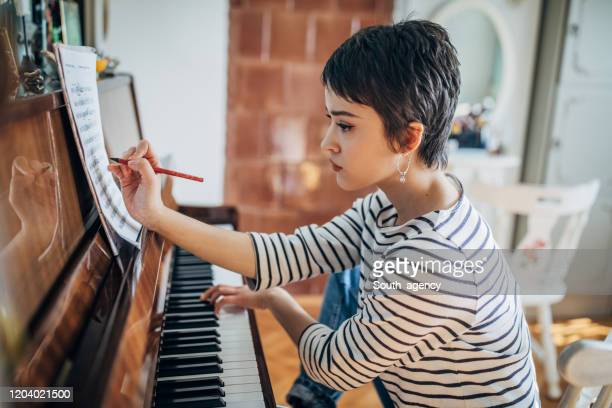 woman composer - musical symbol stock pictures, royalty-free photos & images