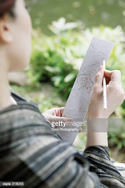 Woman composing a poem, haiku, tanka