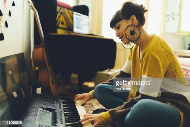 woman composing music - keyboard player stock pictures, royalty-free photos & images
