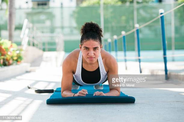 Woman concentrated doing warm-up exercises