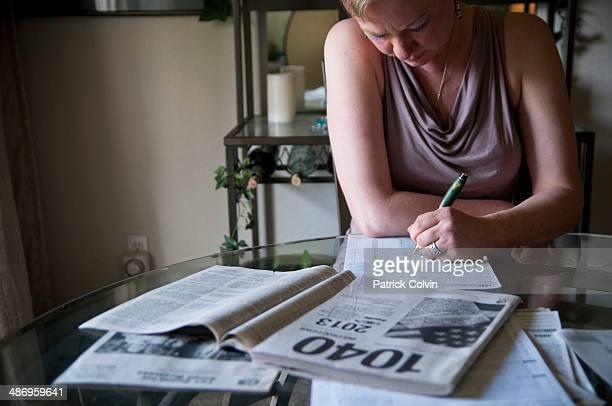 Woman concentrating on taxes