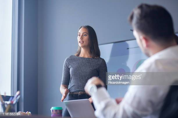 woman conducting a conference in the boardroom - leadership stock pictures, royalty-free photos & images