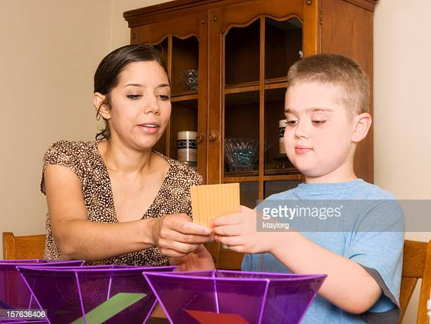 Woman conducting ABA therapy with special needs child