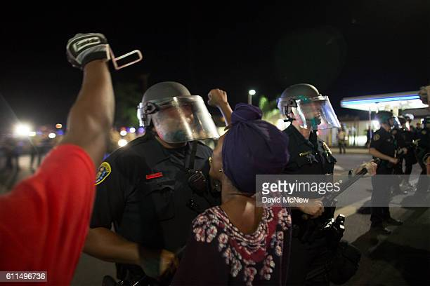 A woman confronts at a police officer while protesting near the site where an unarmed black man Alfred Olango had been shot by police earlier this...
