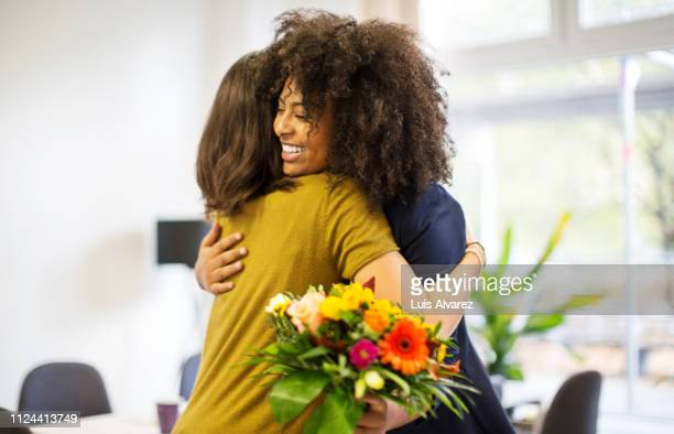 woman congratulating female coworker over her success - admiration stock pictures, royalty-free photos & images