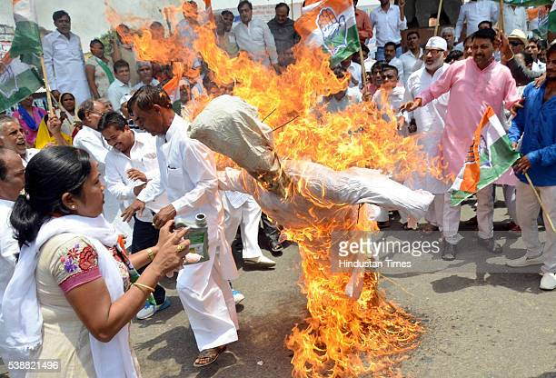 A woman Congress worker suffered burn injuries while she was trying to light the effigy of Prime Minister Narendra Modi during a protest against...