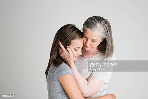 Woman consoling granddaughter