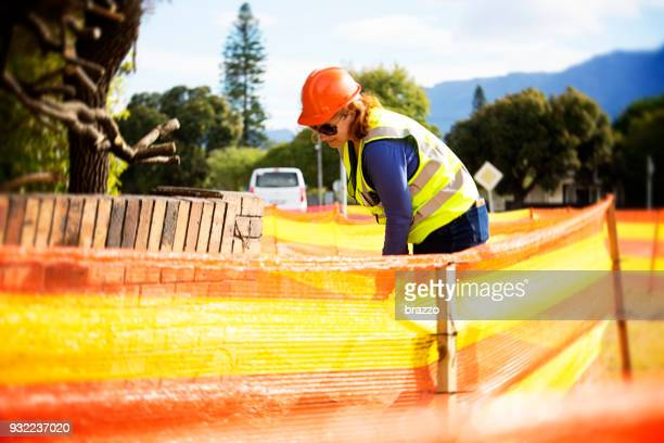 woman construction worker working in the street - crew stock pictures, royalty-free photos & images