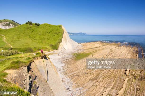 woman contempling the basque coast, zumaya, guipuzcoa, basque country, spain. - ギプスコア ストックフォトと画像