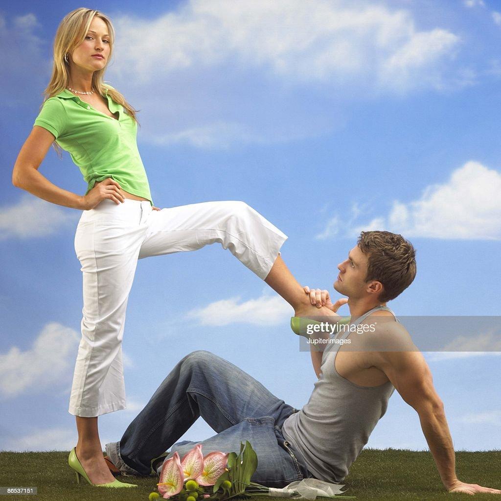 Woman controlling man : Stock Photo