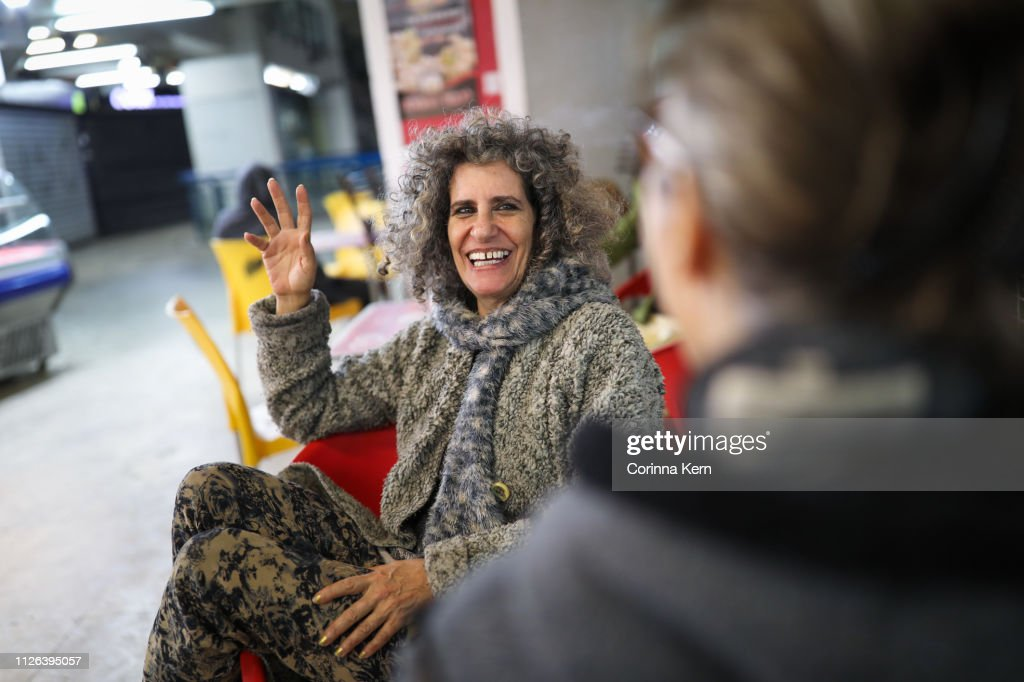 Woman conversing with friend : Stock Photo