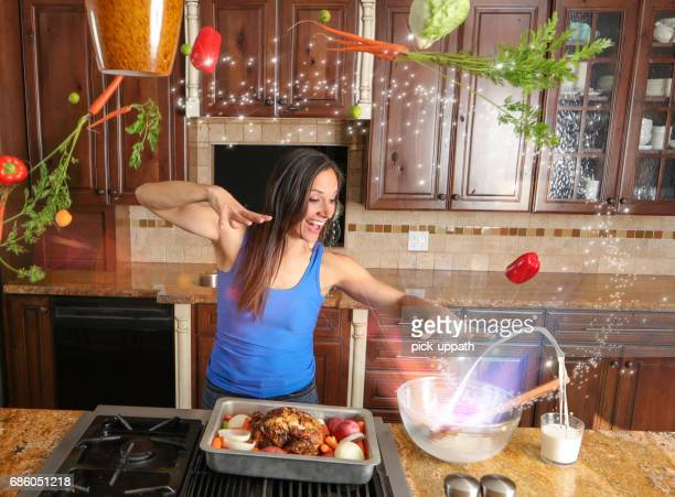 woman cooking a meal with magic - potion stock photos and pictures