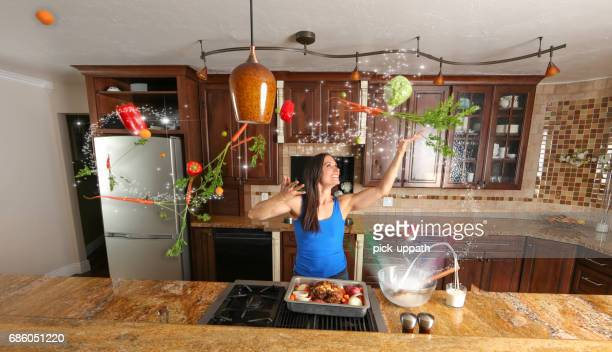 woman cooking a meal with magic - paranormal stock pictures, royalty-free photos & images