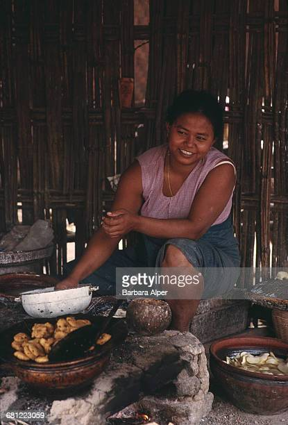 A woman cooking at home in Pagan or Bagan Burma February 1988