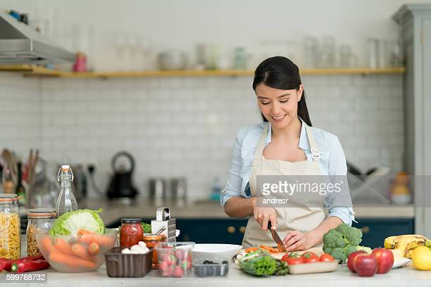 woman cooking at home - chop stock pictures, royalty-free photos & images