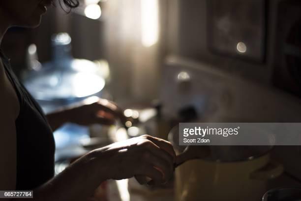 Woman cooking at stove
