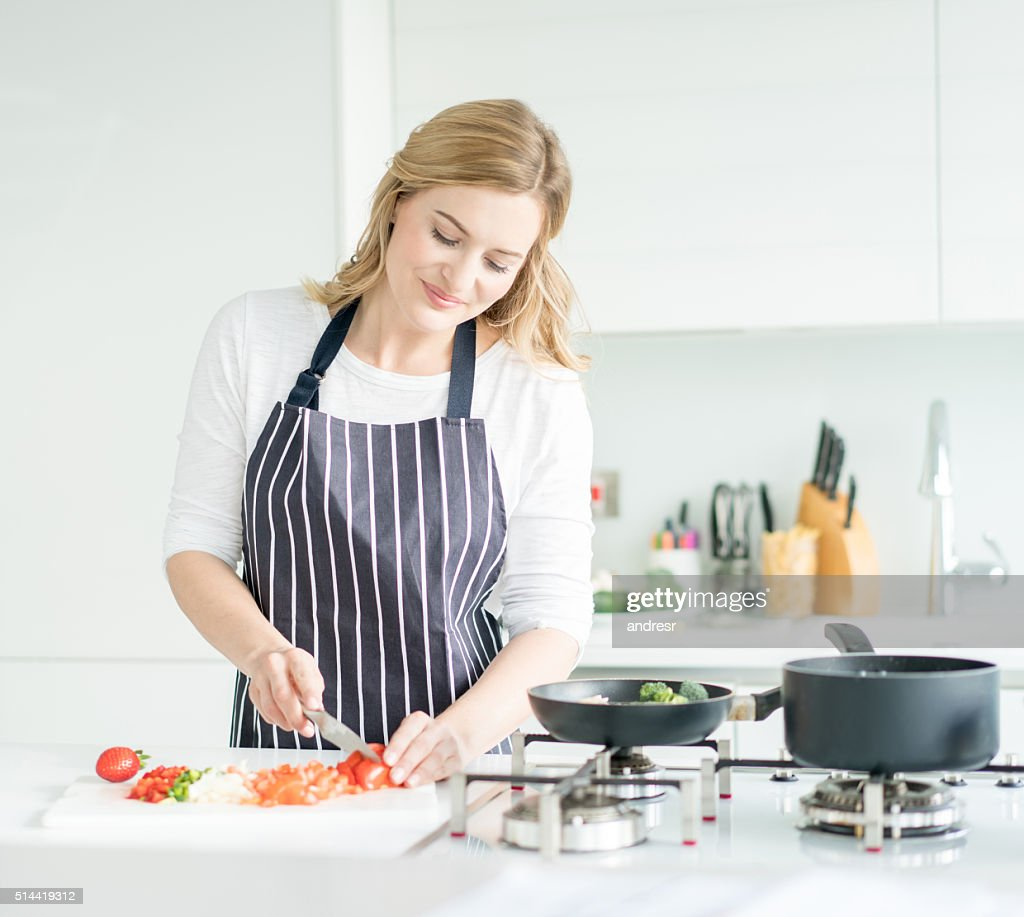 Woman Cooking Dinner At Home Stock Photo