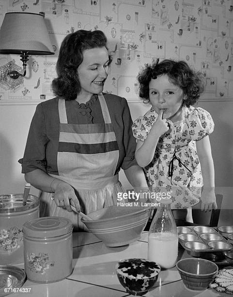 Woman Cooking Food With Her Daughter
