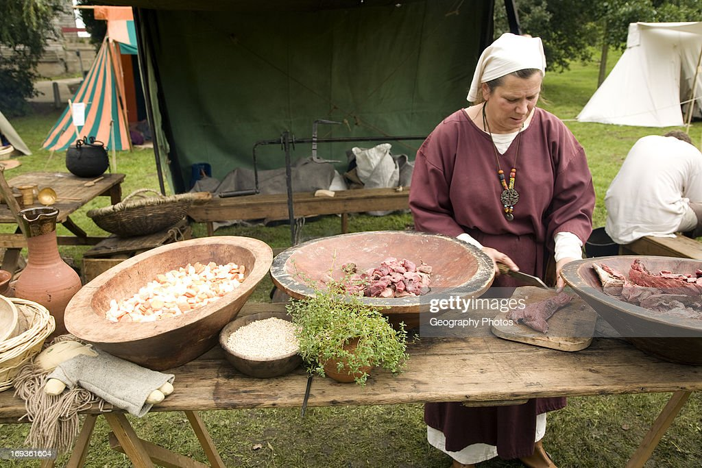 Woman cooking Historical re-enactment Saxon, Viking, Norman history, Woodbridge, Suffolk : News Photo