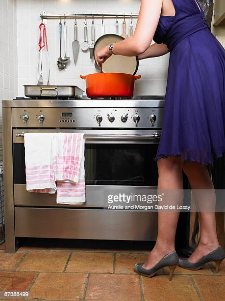 Woman cooking in evening dress