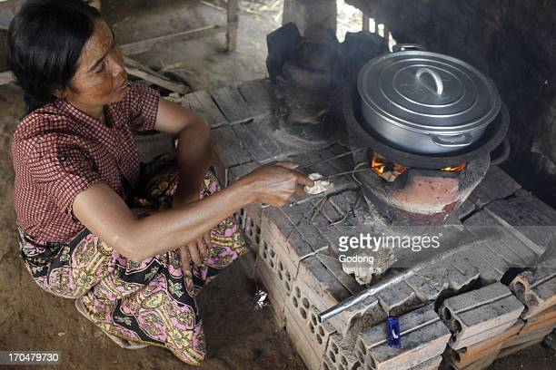 Woman cooking in her kitchen Ko Dach Cambodia