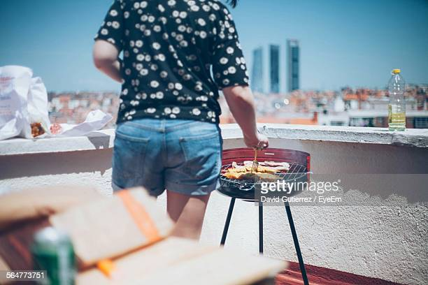 Woman Cooking On Barbecue Grill