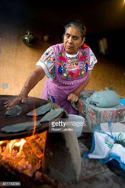 Woman Cooking on Wood Fired Oven