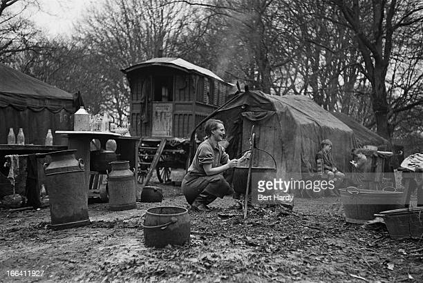 A woman cooking over an open fire at an encampment in the New Forest Hampshire January 1949 She lives in one of six designated compounds in the...
