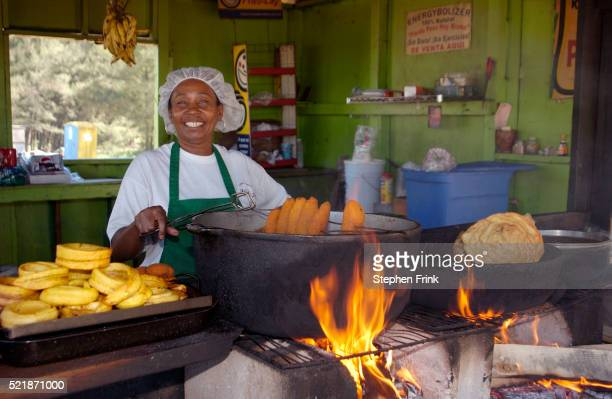 Woman Cooking over Open Flame
