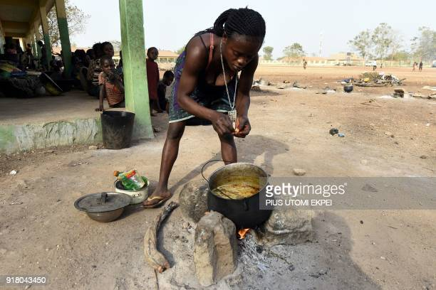 A woman cooks a meal at the internally displaced people camp occupied largely by women and children affected by herders and farmer's violent clashes...