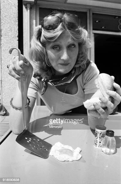 A woman cooks an egg on a car bonnet during the 1976 heatwave 25th June 1976