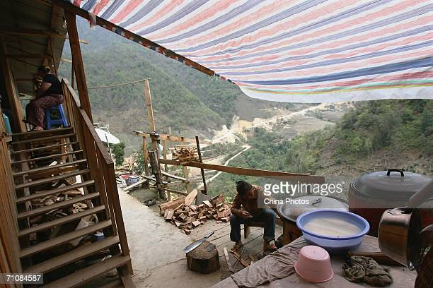 A woman cooks in a molybdenum mine at a village on March 17 2006 in Panwa Kachin State Special Region 1 of Kachin State Myanmar The Kachin State...