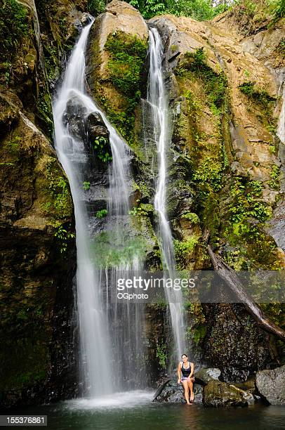 Woman cooling down in a waterfall