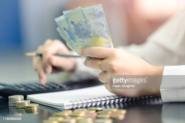 woman counting money euro banknotes, business or stock market concept image. - wages stock photos and pictures
