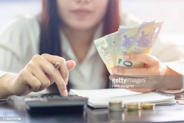 woman counting money euro banknotes, business or stock market concept image. - geld stock-fotos und bilder