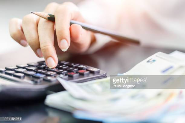 woman counting money euro banknotes, business or stock market concept image. - bank account stock pictures, royalty-free photos & images