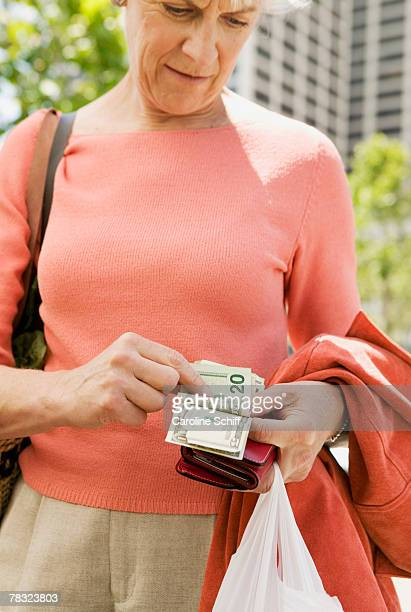woman counting money - schiff stock photos and pictures