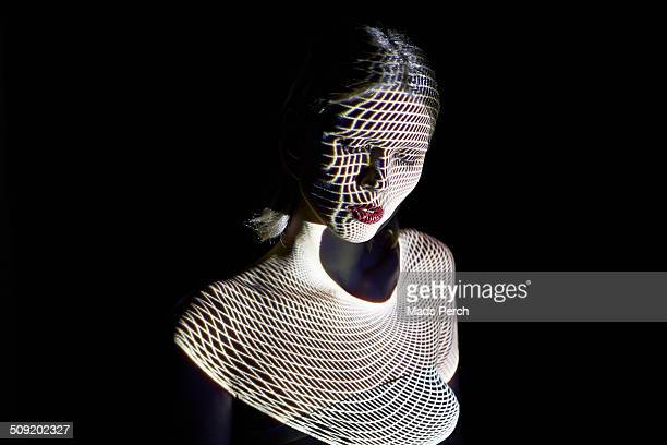 Woman Covered by Futuristic Patterns of Light