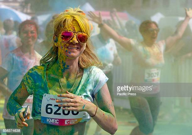 A woman covered in colored powder participates in an annual 'Color Run' in Kiev The running event is inspired by the Hindu Holi festival of colors