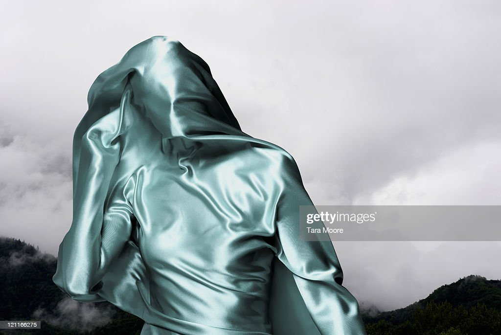 woman covered in green material with sky : Stock Photo