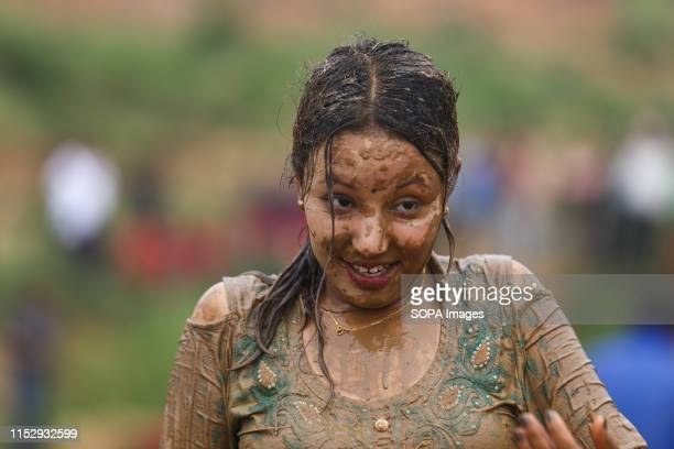 A woman covered in mud during a Festival Farmers celebrate National Paddy Day Festival on 'Asar 15' of the Nepali calendar as the annual rice...
