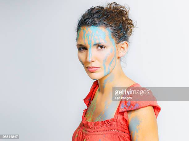 Woman covered in paint