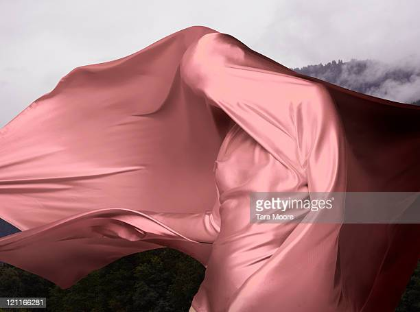 woman covered in pink material outdoors