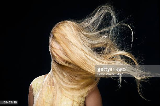 woman covered with blowing hair in wind. - blonde hair stock pictures, royalty-free photos & images