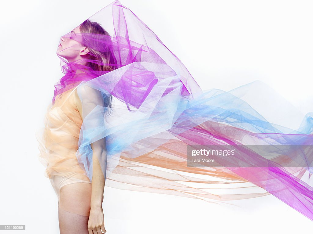 woman covered with bright colorful material : Stockfoto