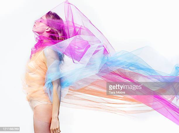 woman covered with bright colorful material - women wearing see through clothing stock photos and pictures